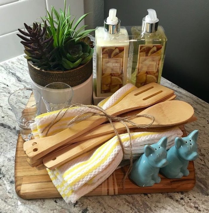 wooden cutting board, diy gift basket, towels and spatulas, what is a good housewarming gift, potted succulents