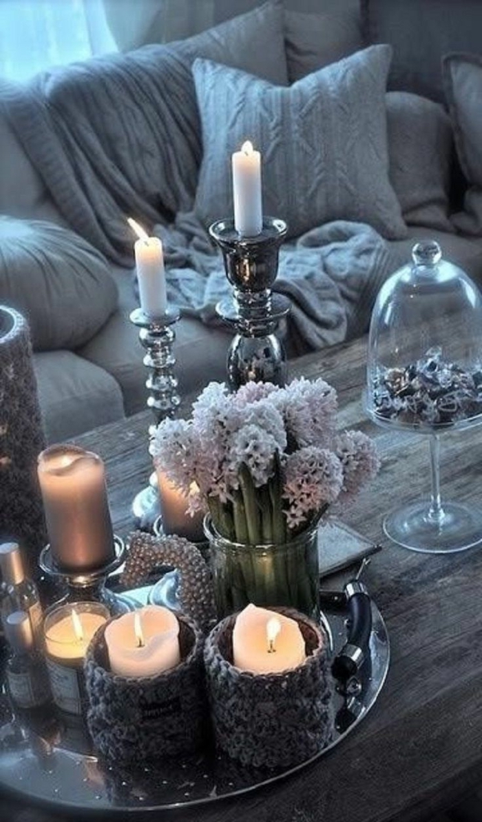 metal tray, candles in candle holders on top, table arrangements, round glass vase, bouquet of hyacinth flowers