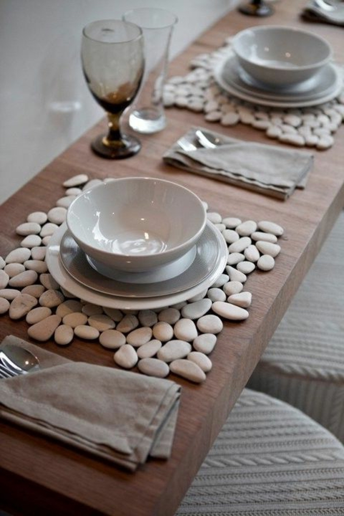wooden table, white and grey plates and bowls, table arrangements, grey cotton napkins, wine glasses