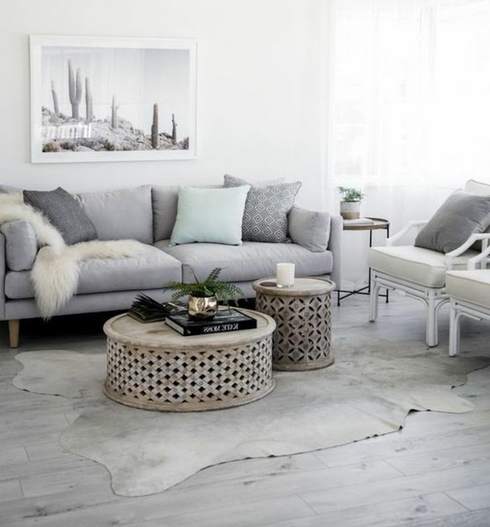 wooden round coffee table, grey sofa, light blue throw pillow, white armchairs, popular living room colors