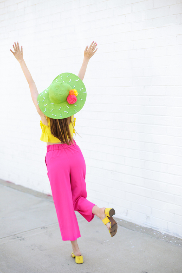pink trousers, yellow top and shows, green hat, diy christmas gifts for mom, pink orange yellow pom poms