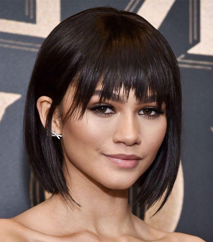 black hair, zendaya with bangs, short wavy hairstyles, bow earrings