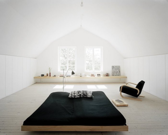 a shaped ceiling, white walls, master bedroom ideas, wooden bed, black armchair, black bed linen