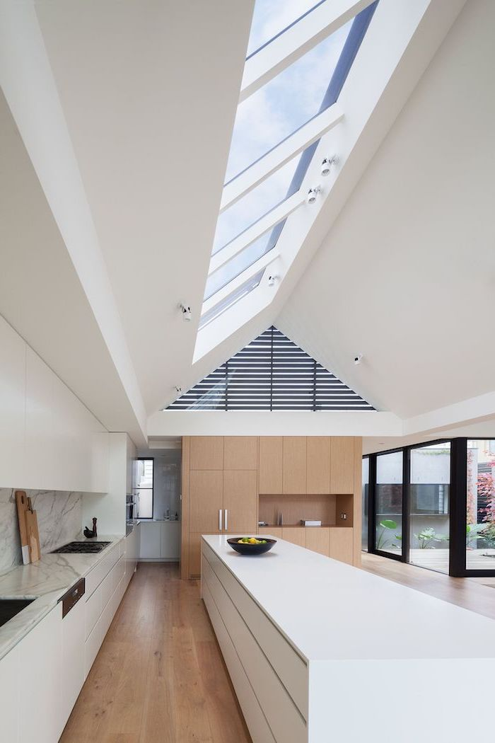 a shaped ceiling, kitchen island ideas, white kitchen island, marble countertop and backsplash