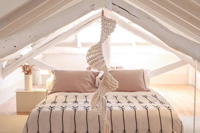 a shaped level, macrame wall hanging patterns, wooden floor, pink pillows