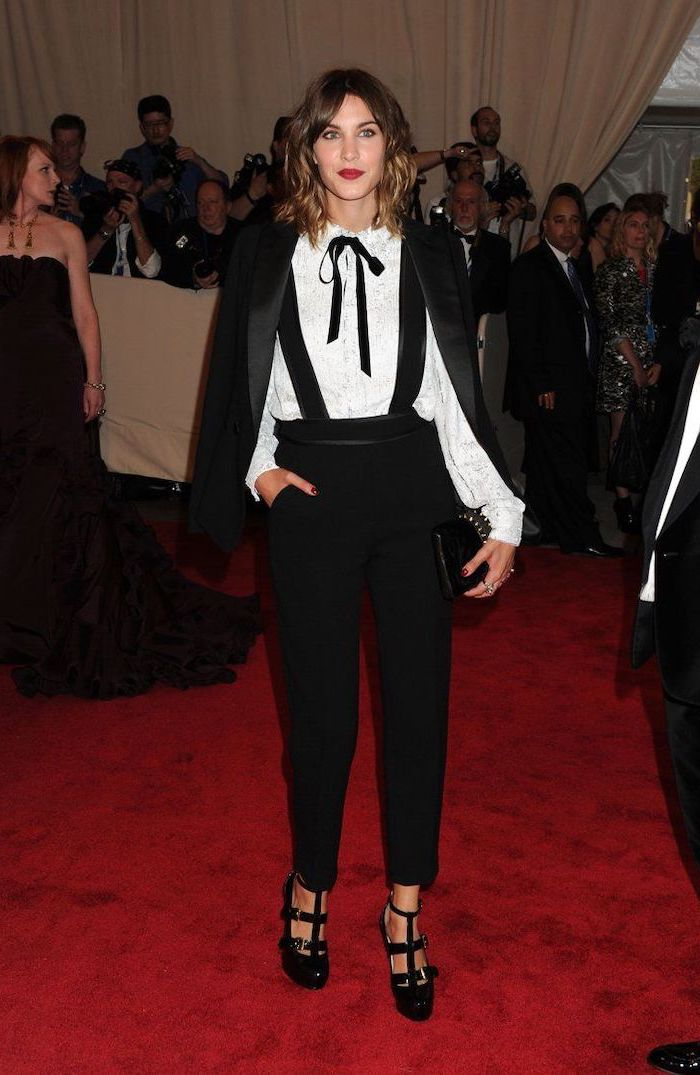 alexa chung, black trousers, black blazer, white shirt, costume institute, black suspenders