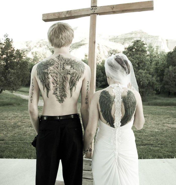 relationship tattoos, woman wearing a wedding dress, angel wings, back tattoo, wooden cross