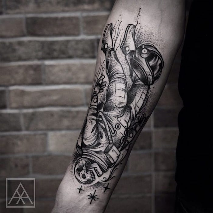 forearm tattoos for men, brick wall, astronaut skeleton, forearm tattoo