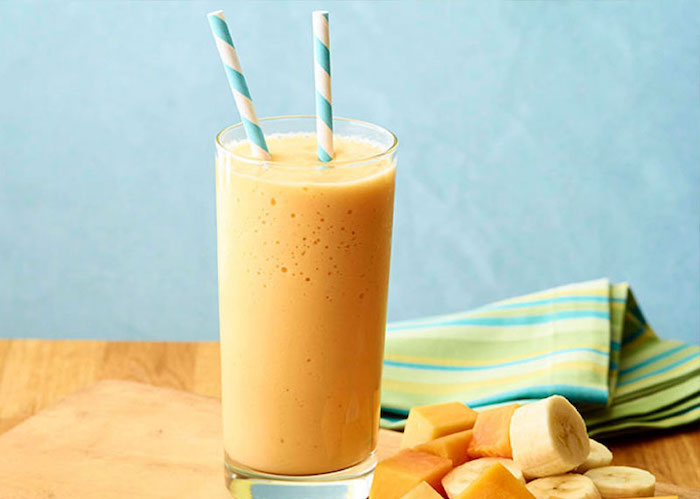 colourful cloth, blue and white paper straws, banana and mango slices, strawberry banana smoothie recipe