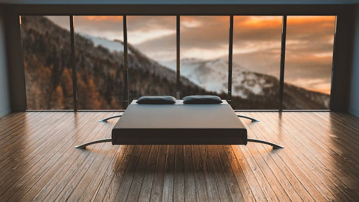 bedroom ideas for women, minimalist style, large windows, wooden floor, bed in the middle