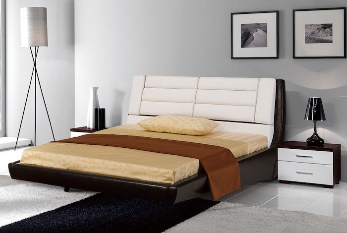 white leather head board, black bed frame, bedroom ideas for women, white walls, black and white carpet