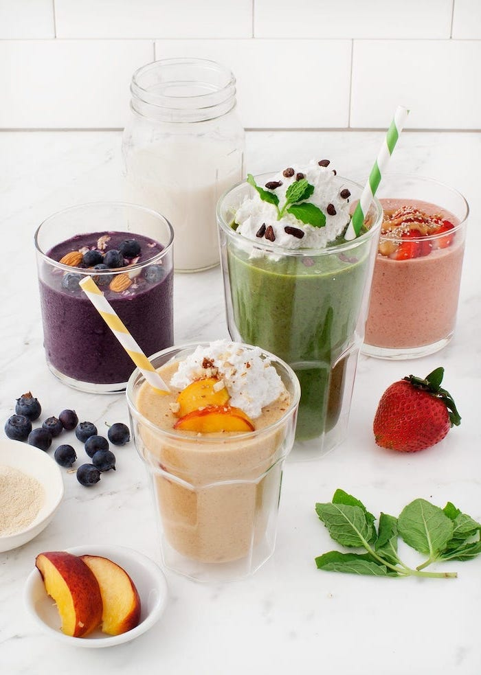 banana smoothie recipe, different smoothies, in different glasses, fruit slices around