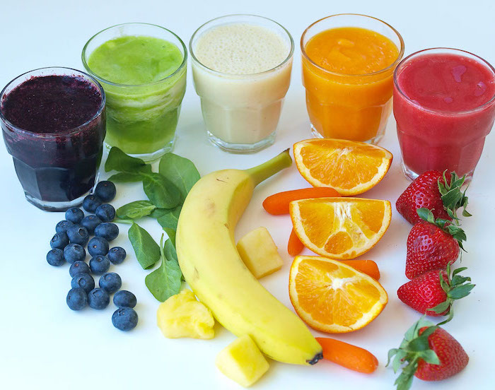 small glasses, filled with different smoothies, smoothie recipes, berries and spinach, banana and mango