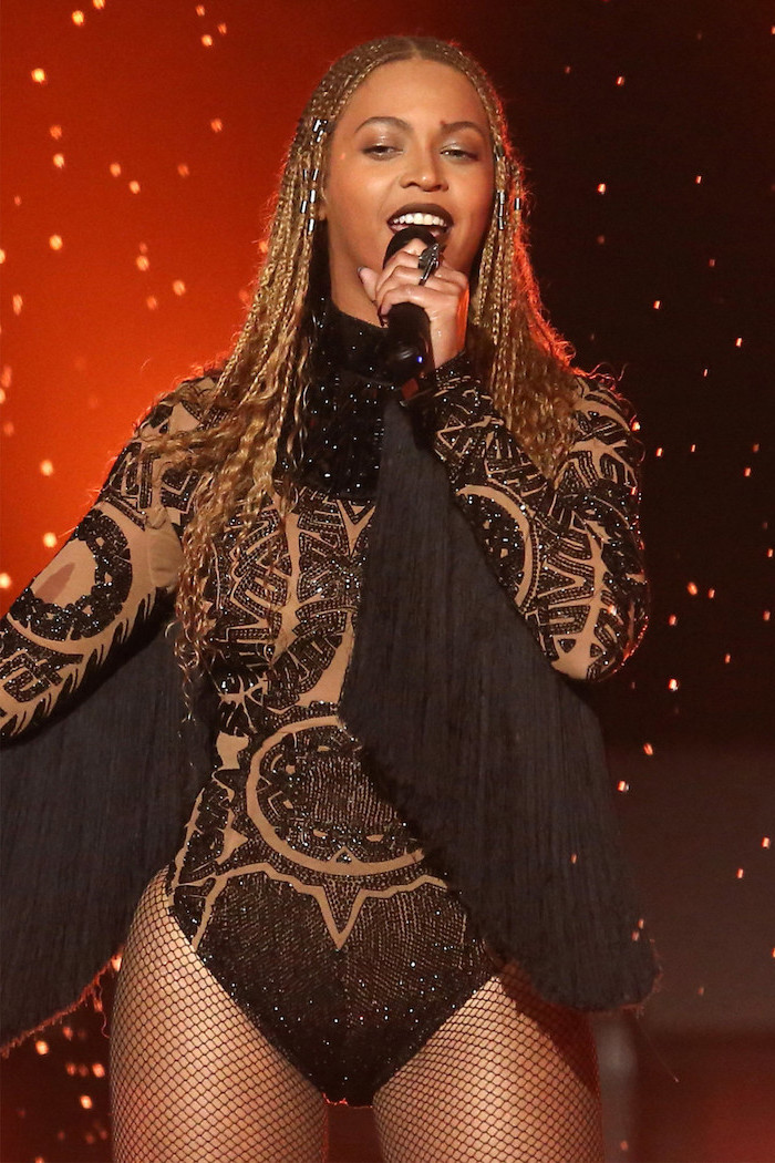 beyonce singing, wearing a black bodysuit, straight back braids, holding a microphone