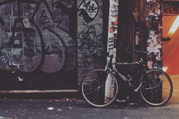 city sidewalk, bicycle leaning on a wall, covered in graffiti, wallpaper tumblr