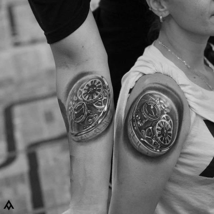 biomechanical shoulder tattoos, relationship tattoos, black and white photo