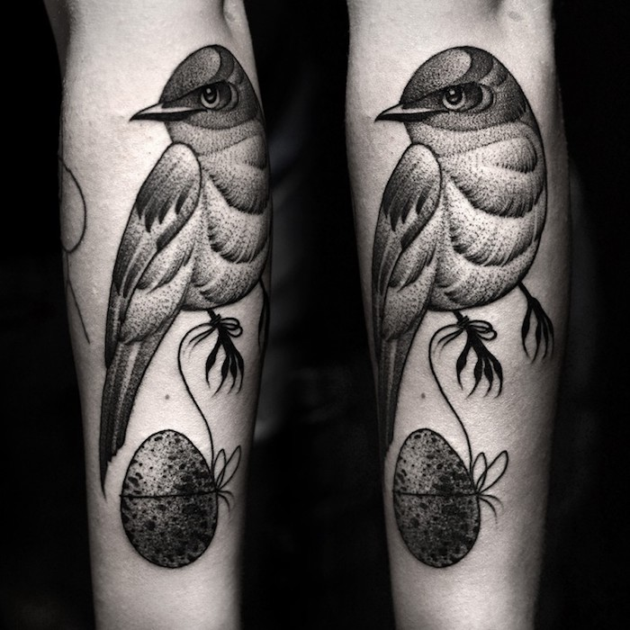bird tied to an egg, forearm tattoos for men, black background, side by side photos