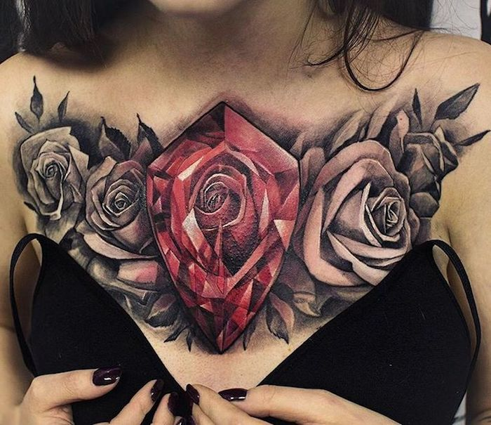 large red crystal, four roses, chest tattoo, cute tattoos for girls, black bra, black nail polish