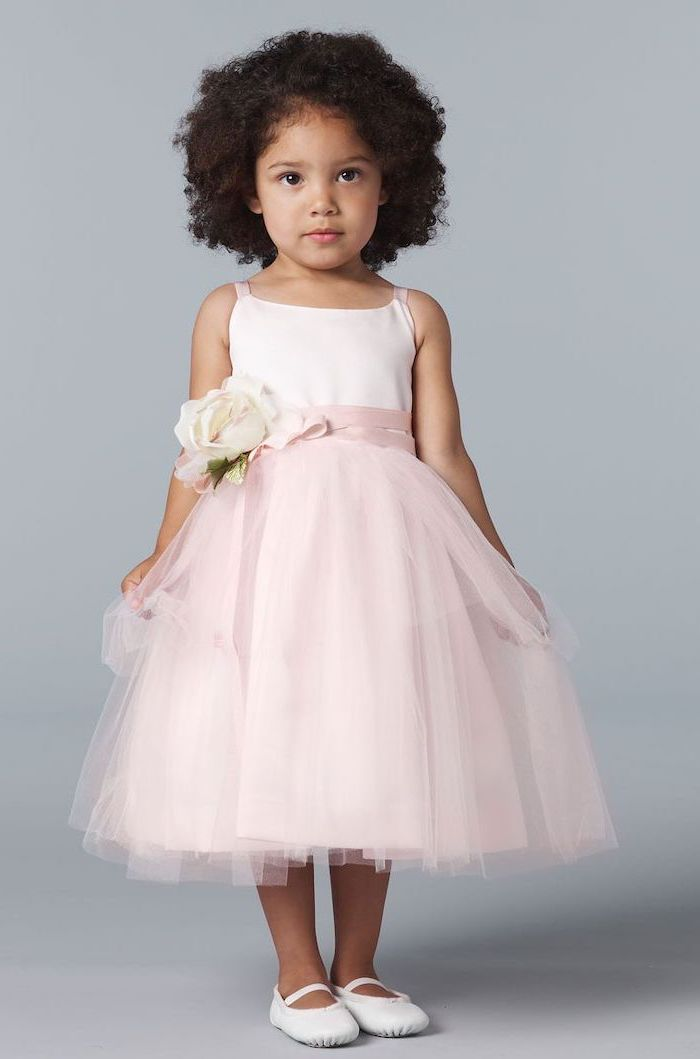 light pink tulle dress, flower girl dresses, white shoes, short black curly hair, pink rose on the ribbon belt