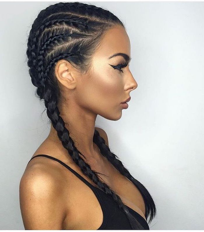 girl with black hair, wearing a black top, ghana braids styles, in front of a white background