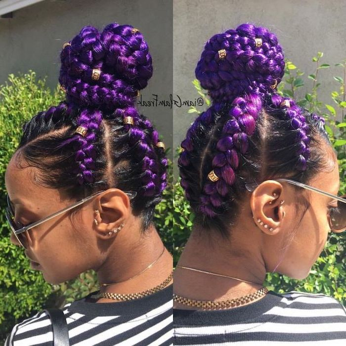 woman with black and purple hair, ghana braids styles, in a bun, black and white striped blouse
