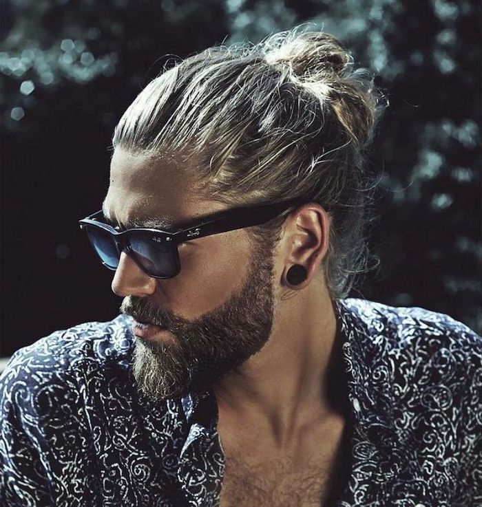 man wearing sunglasses, guy hairstyles, blonde hair, in a man bun, black and white shirt