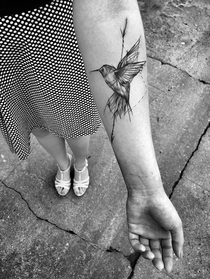 geometrical bird flying, meaningful tattoos, forearm tattoo, black and white photo