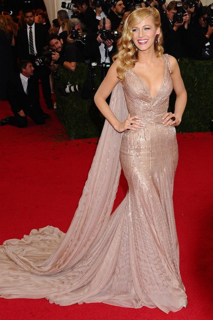 blake lively, wearing a beige sequinned dress, met gala, on the red carpet, with long blonde hair