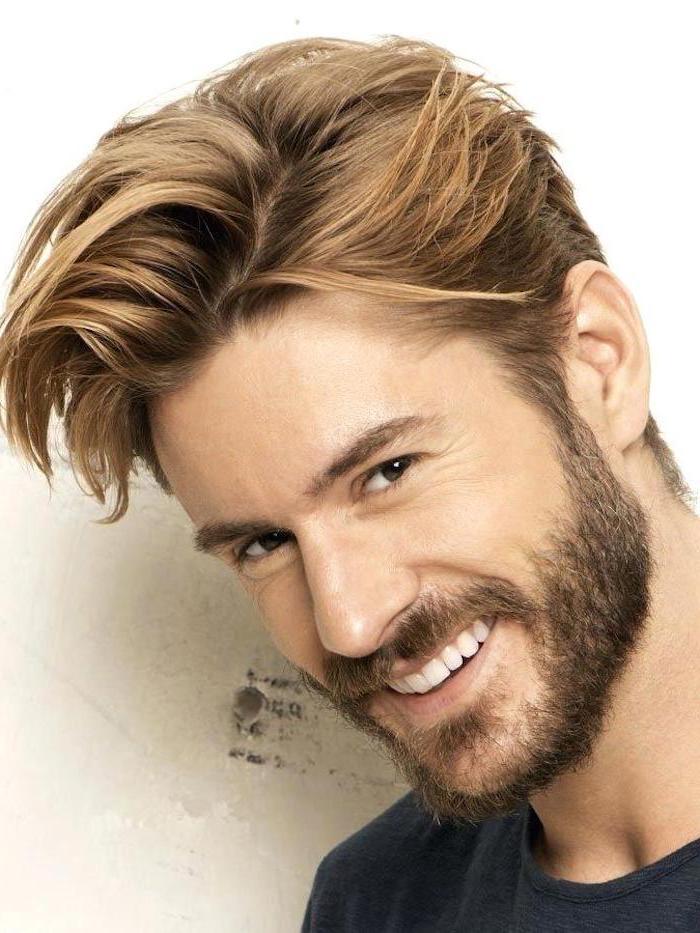 man smiling, black shirt, medium length hairstyles for men, blonde hair