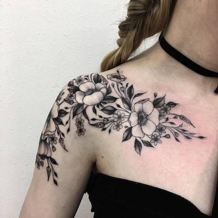 braided blonde hair, flower shoulder tattoo, small tattoos for girls, black top, black choker
