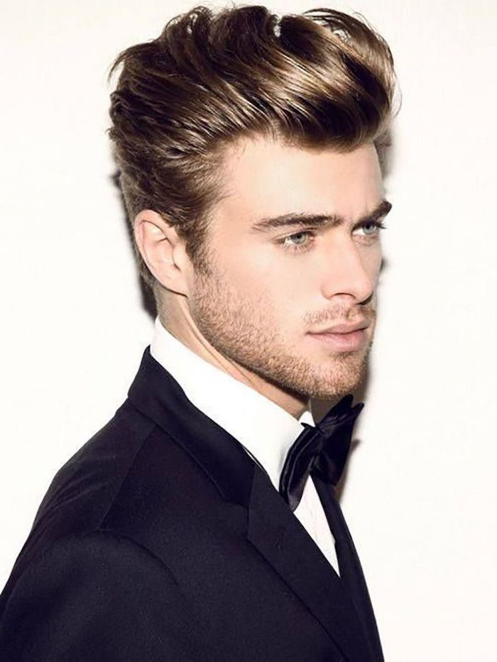 blonde hair, short sides long top haircut, black jacket, black bow tie, white shirt