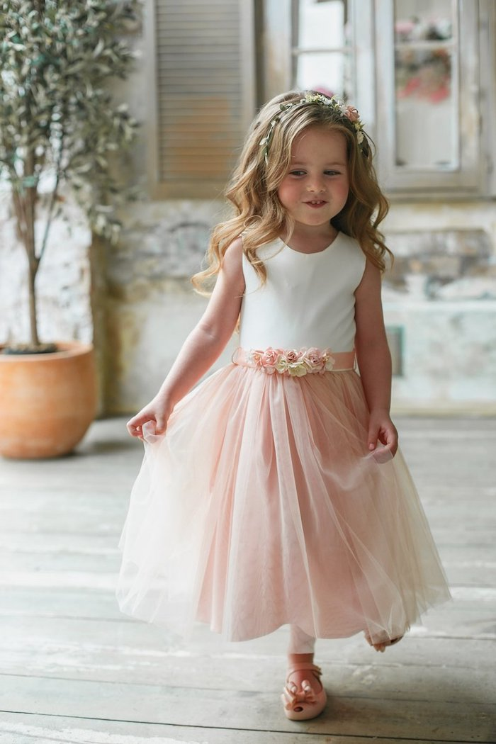 long blonde wavy hair, flower girl dresses, white top, pink tulle bottom, wooden floor, pink shoes, flower crown