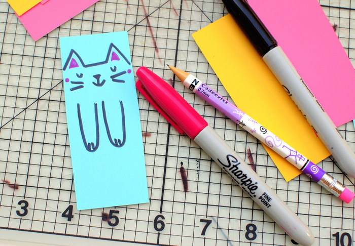 colourful paper, cat face and paws drawn on blue paper, preschool activities, black and pink sharpies