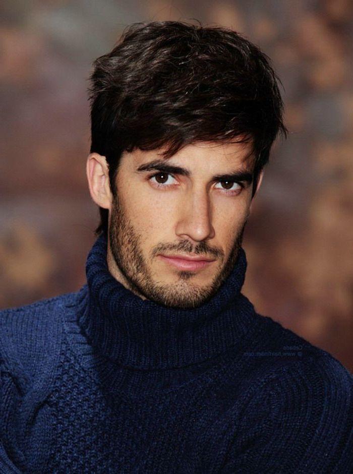 blue polo sweater, black hair, short sides long top haircut