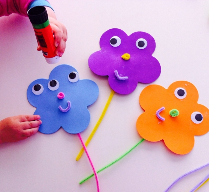 colourful flowers, made of felt, with googly eyes, school themes, blue purple and orange