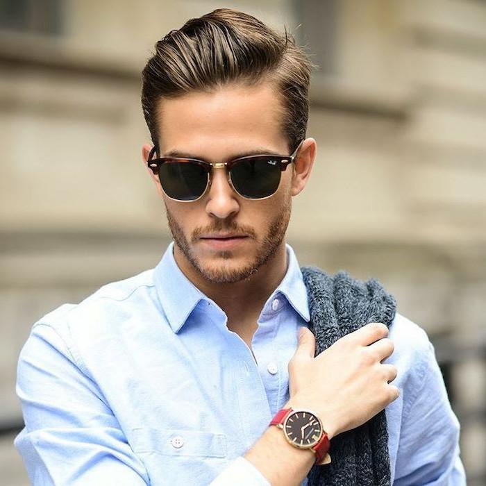 best haircuts for men, blue shirt, grey cardigan, brown hair, man wearing sunglasses