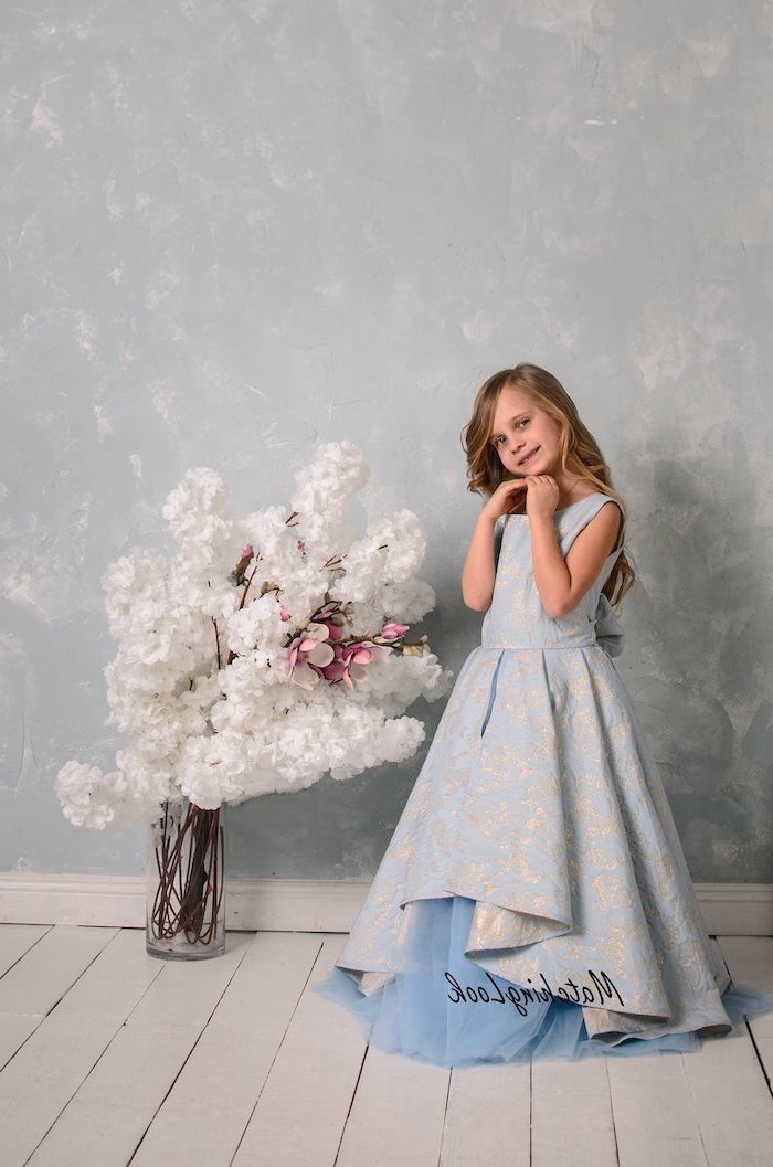 blue and gold, vintage dress, cute girl outfits, white flowers bouquet, wooden floor, long blonde wavy hair