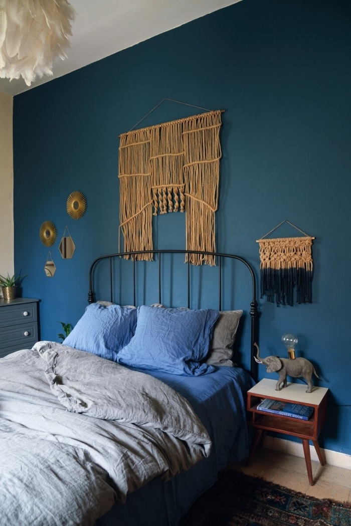 blue wall, blue pillows, free macrame patterns, wooden night stands, grey bed linen