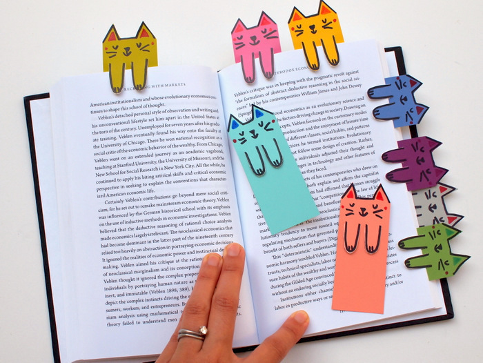 book dividers, made of colourful paper, with cat faces and paws drawn on it, pre k learning games