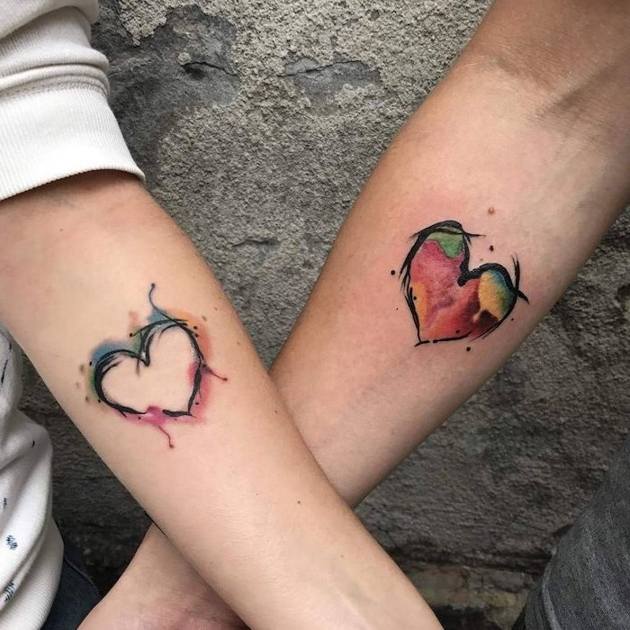 watercolour hearts, matching tattoos, forearm tattoos, cement background