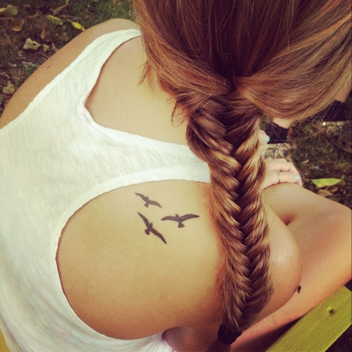 braided blonde hair, white top, birds flying, shoulder tattoo, arm tattoos for girls
