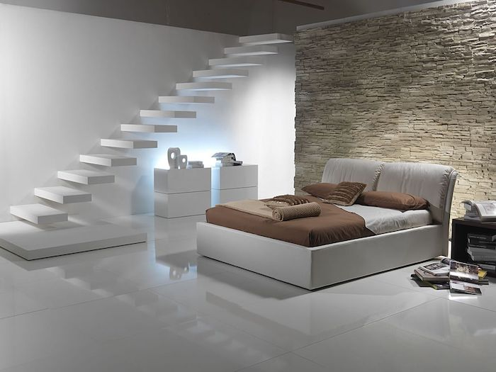 stone wall, white staircase, white leather bed, bedroom design ideas, white tiled floor, minimalist style