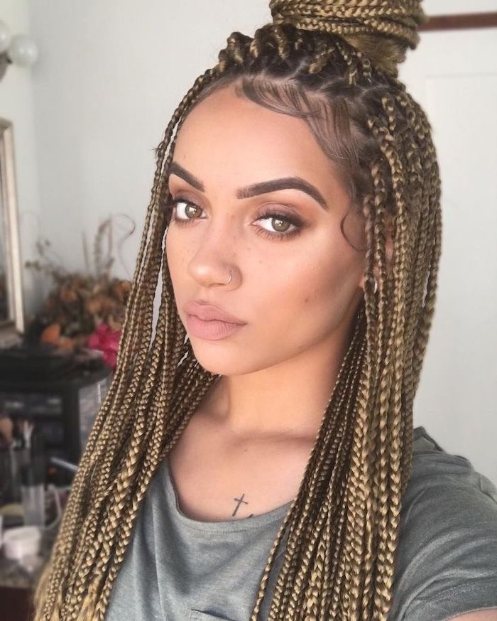 woman with light brown hair, in a bun, braid hairstyles with weave, wearing a grey t shirt