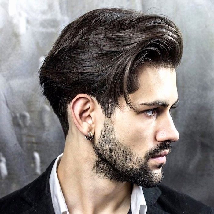 black hair, white shirt, black jacket, short sides long top haircut, grey background