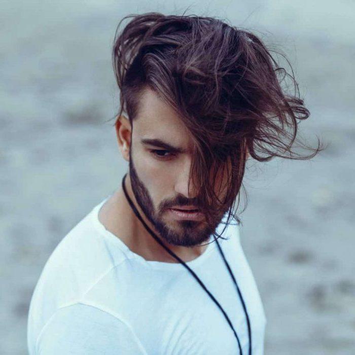 long brown messy hair, white shirt, short guy haircuts, black necklace, black beard