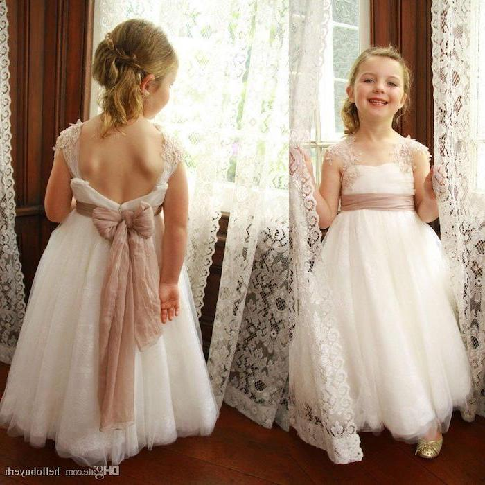 white tulle and lace dress, ivory bow, blonde hair, in a low updo, girls party dresses, white lace curtains