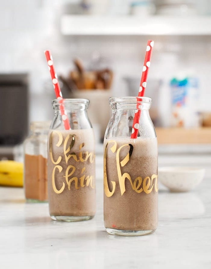chin chin, cheers bottles, red straws, how to make a strawberry smoothie