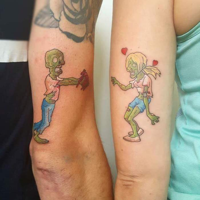 green zombies, back of arm tattoos, matching tattoos, one holding a heart