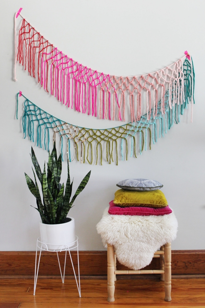 colourful macrame decoration, macrame diy, wooden chair, colourful throw pillows, potted plant