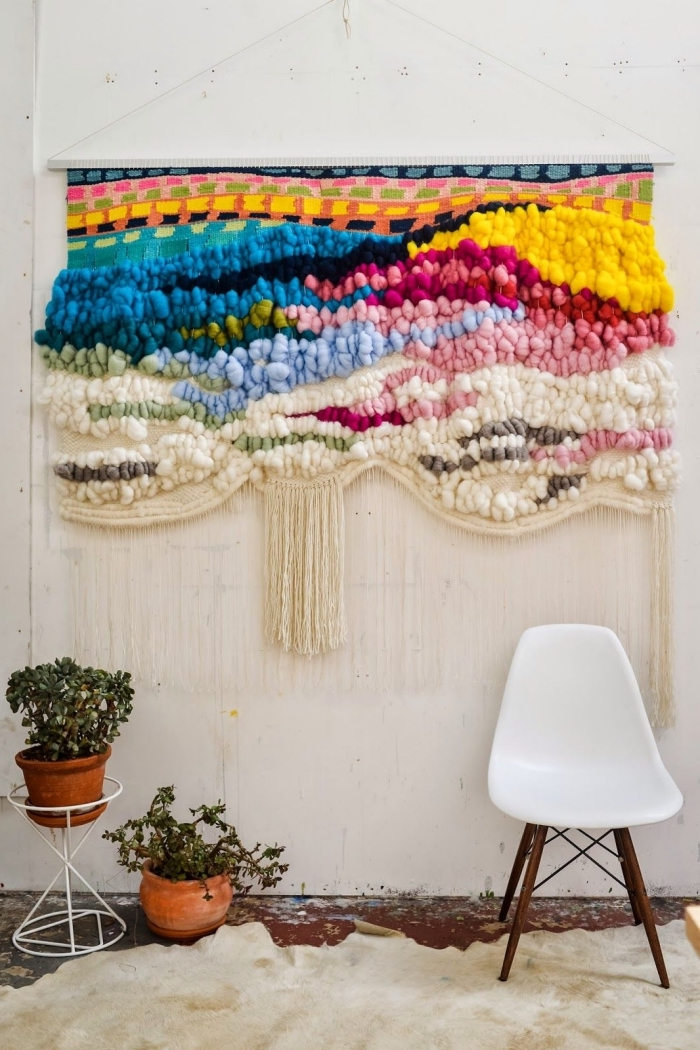 white armchair, large colourful macrame decoration, potted plants, macrame tutorial